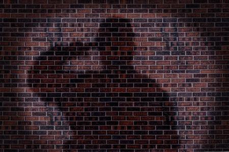 Militaire soldaat groeten, schaduw op een bakstenen muur. Stockfoto - 89958509