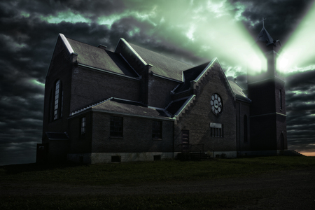 Ray of light coming from the bell tower of one haunted church. Photo manipulation, 3D illustration.