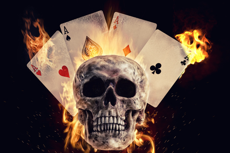 Skull and playing cards in fire on a black background. Photo manipulation artwork, 3D rendering. Stock fotó