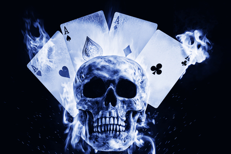 Skull and playing cards in fire on a black background. Photo manipulation artwork, 3D rendering. 스톡 콘텐츠