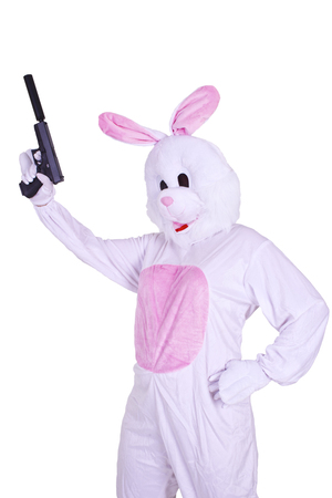 Rabbit mascot with a gun. Isolated on white background. 版權商用圖片