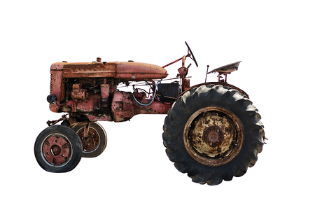 Rustic old red tractor, isolated on white background. Agriculture concept