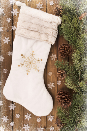 Christmas stocking and decoration on wooden table, directly above.
