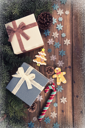 Gift boxes and decoration under Christmas tree, wooden plank in background, directly above. Imagens