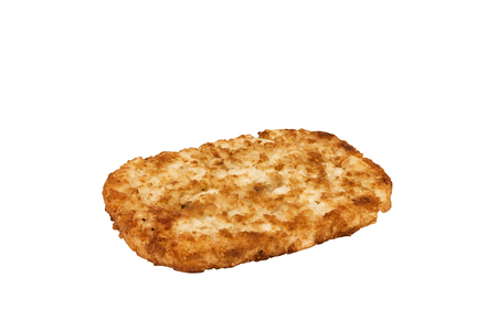 Close up on a crispy hash brown isolated on a white background. Breakfast concept.