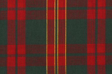 Close up on classic red and green tartan fabric. Directly above.