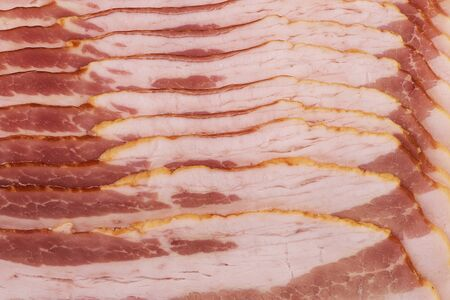 Background of bacon slices disposed in a line and directly above. Close up.