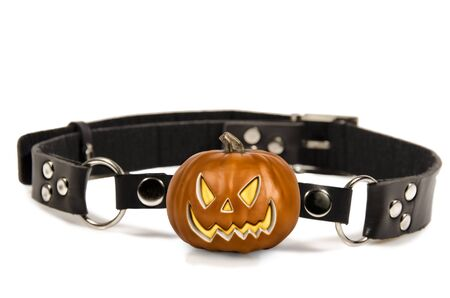 Scary pumpkin head as ball gag, isolated on a white background. Copy space for your text. Stok Fotoğraf