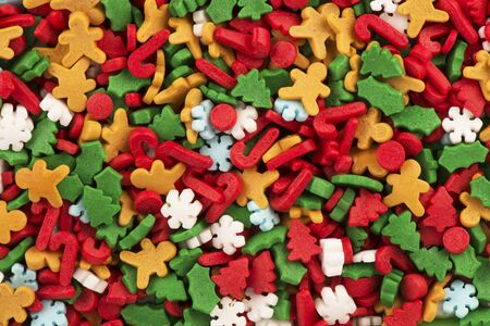 Top view on background texture of colorful Christmas candies.
