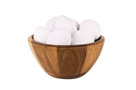 Bowl of fresh eggs isolated on white background. Cut out.