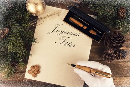 Santa Claus writing a letter, directly above. Flat lay for Christmas concept. Stok Fotoğraf