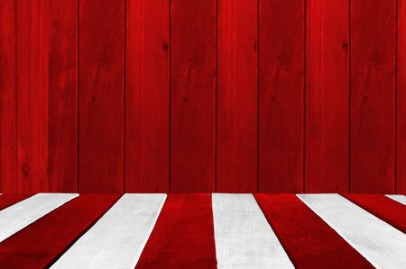 Christmas holiday background with empty wooden table. Red and white plank look alike a Christmas candy cane.