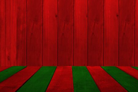 Christmas holiday background with empty wooden table. Red and green plank look alike a Christmas ribbon.