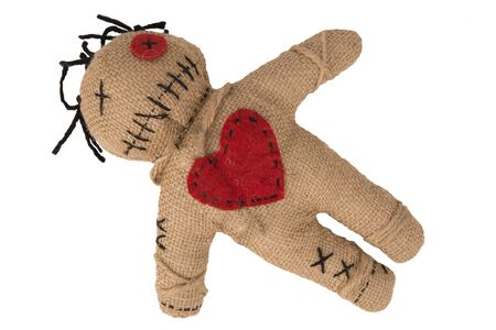 Voodoo doll with in burlap fabric, isolated on white background. Directly above. Cut out.