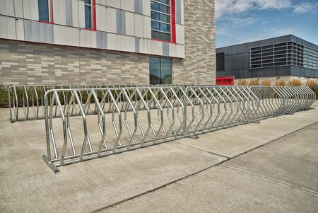 Bike parking of an elementary school building, backside. Sunny spring day.