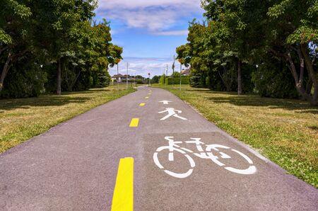 Bike lane. Road sign Bicycle on road. Bike path. Print on surface bitumen.
