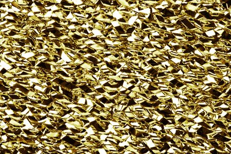 Gold crumpled metal foil texture. Metal glossy surface background.