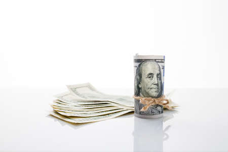 strangulation: Banknote one hundred dollars, tied with rope, and US dollars Stock Photo