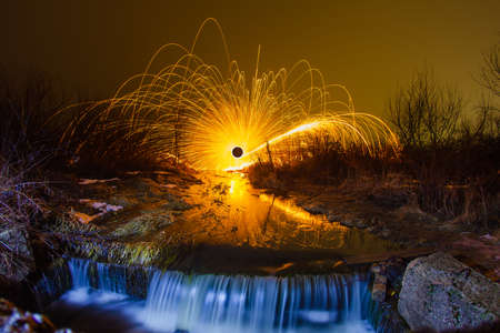 steel wool: Sparks from the burning steel wool and waterfall