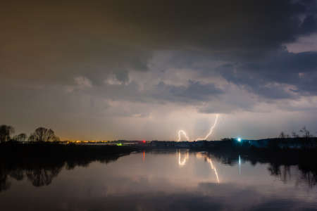 Rain and lightning above the river