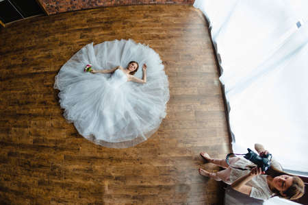 elegance fashion girls look sensuality young: Photographer is taking pictures the bride