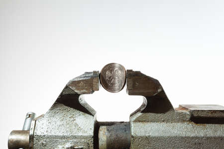 vise: The Russian coin in vise Stock Photo