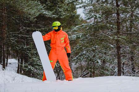 Snowboarder posing in winter forest 版權商用圖片