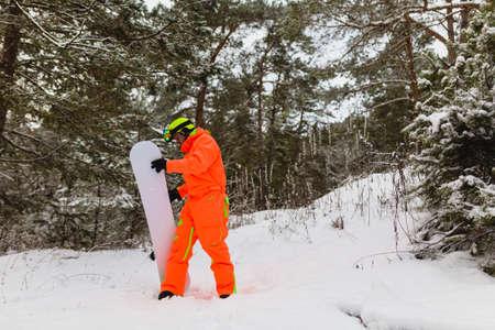 Snowboarder checks his equipment Stock Photo