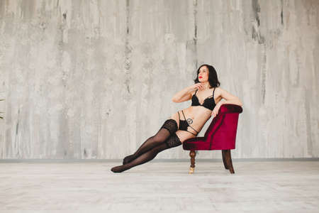 Sexy brunette in black lingerie and stockings