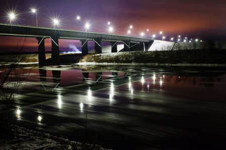Street lights reflected on the water surface and night landscape Stock Photo