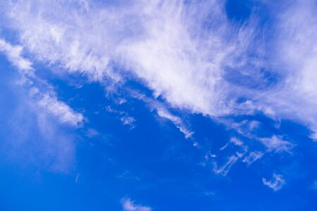 cirrus clouds against a blue sky