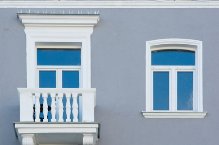 window and window with a white balcony on a gray wall background Stock fotó