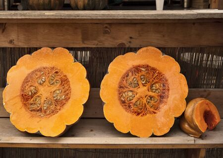 two and a half: two half of an orange pumpkin