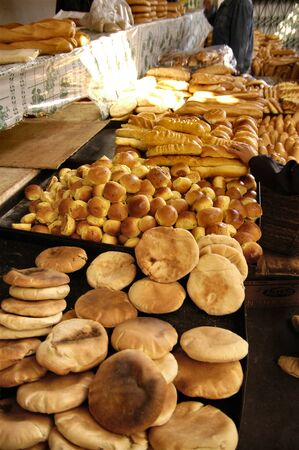 greediness: various bread in a tunisian market street food