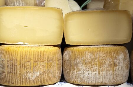 greediness: italian crafts cheeses, handmade from cow milk Stock Photo