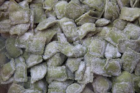 raviolo: green fresh pasta with stuffing called raviolini