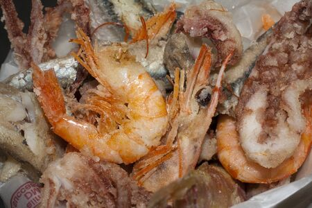 fish fry, frittura di pesce with shrimps, squid and anchovies photo