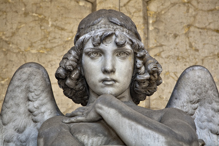monumental cemetery: portrait of angel on marble, monumental cemetery of Genoa, more than 100 years old statue