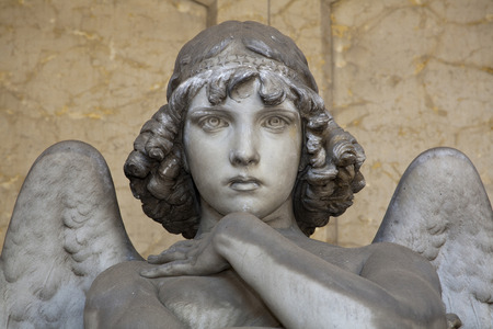 the angel of death: portrait of loving angel on marble, in monumental cemetery of Genoa, more than 100 years old statue