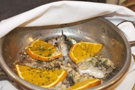panful: sardine with oranges, pine nuts and vegetables