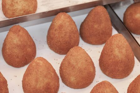 typical southern italian food called arancino or arancina