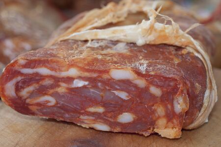 typical southern italian salumi called soppressata, with pepper, spicy