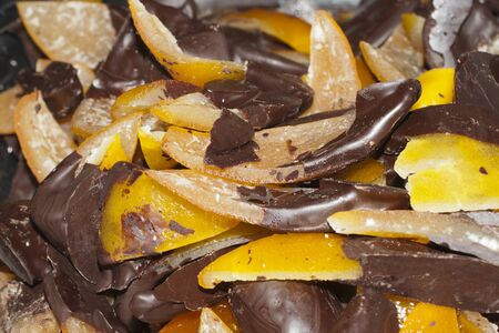 typical italian sweet: fruit with chocolate, peel of oranges with chocolate