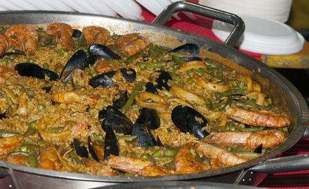typical spanish food: paella with fishes and vegetables
