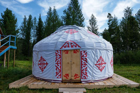 traditional kazakh yurt house in Eastern Kazakhstan in summertime with forest on background Stock Photo