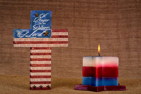 Cross with prayer for soldiers and candle