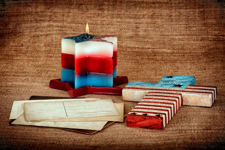 Patriotic Background with candle cross and postcards Stock Photo