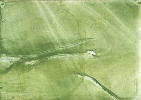 Vague watercolor painted on paper sheet. Green khaki background. Фото со стока