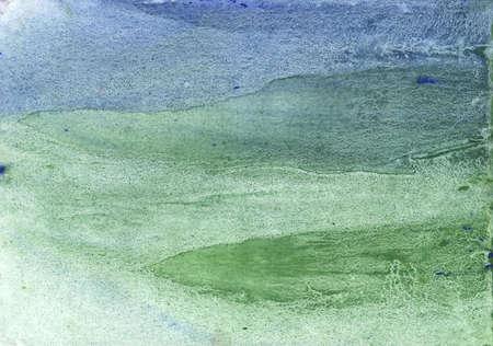 Nebulous work painted on paper sheet. Dark sea green watercolor painting.