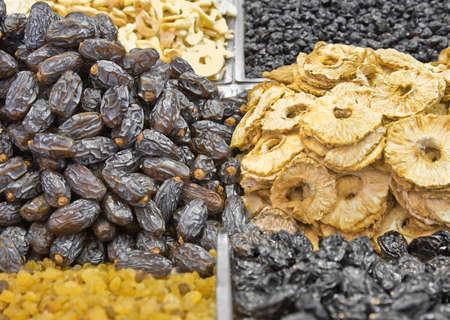 Dates and dried fruits popular for ramadan fiest at the arabic market photo